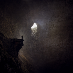 Man alone in a cave