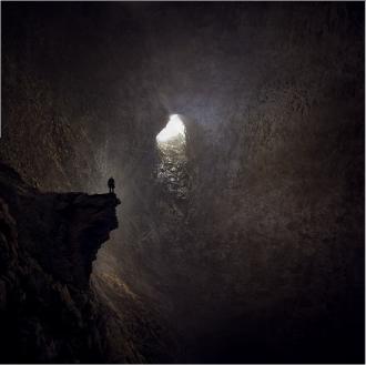 Man alone in a cave