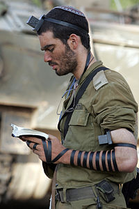 Soldier praying with Tefillin