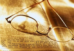 Glasses on Open Bible